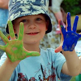 photo of children painting hands