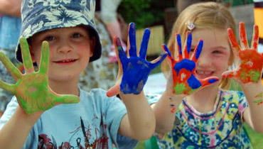 Children with paint on their hands