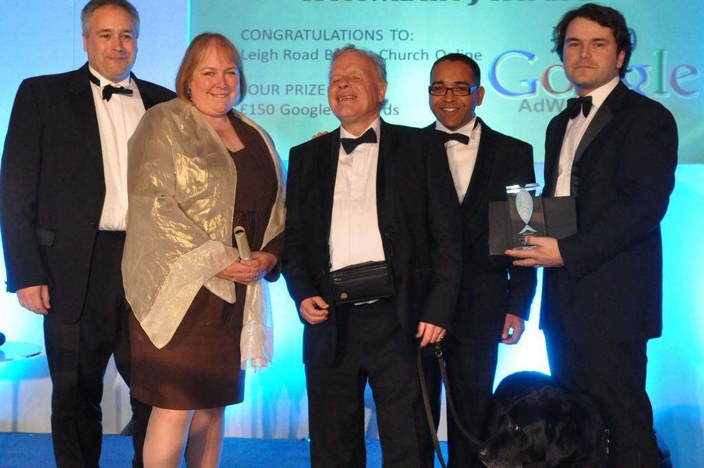 Win for LRBC and ECRU at CNMAs: Left to Right: Matt Williams ECRU Managing Director, Sarah Lennard-Brown ECRU Director, Dr Mike Townsend Torch Trust, Dr. Krish Kandiah CNMAs Host, Tom the Guide Dog and David Elcock Community Worker Leigh Road Baptist Church