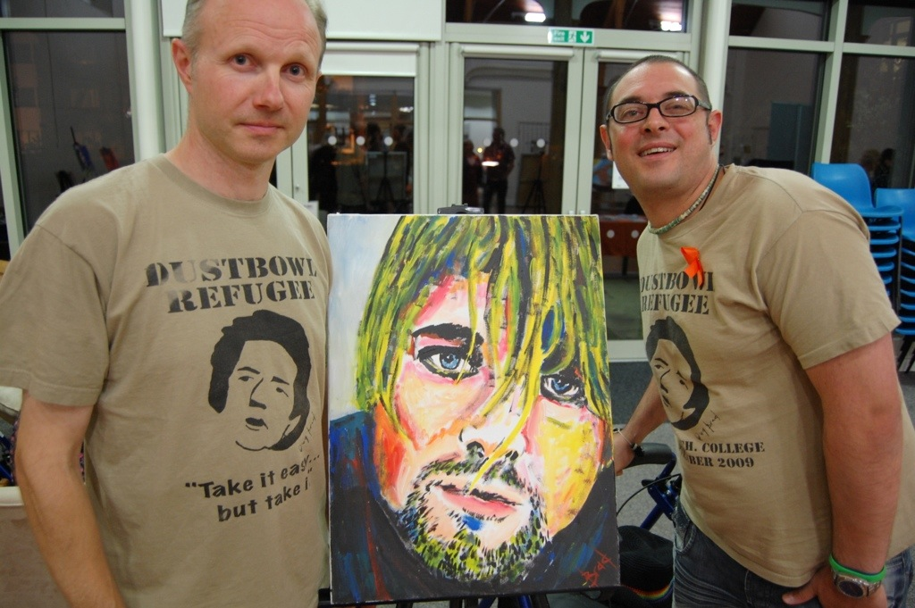 Brad and event organiser Alan Cook pose with the artist's favourite painting – Kurt Cobain